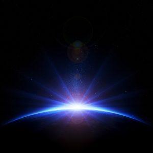 Sunrise creating lens effect on earth